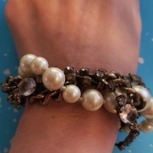 Brass & pearl w/ 2 Crystal links.